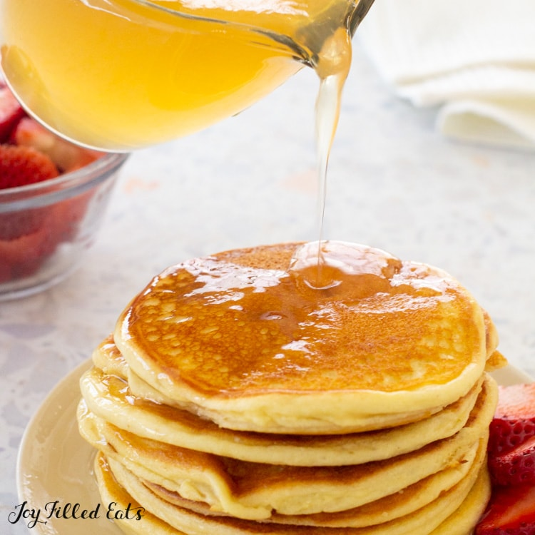 keto pancake syrup being poured over pancakes