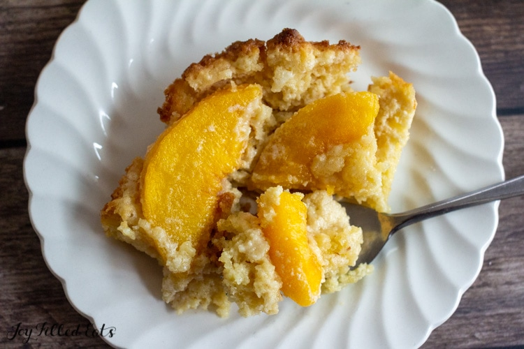 overhead shot of piece of a bite of keto peach cobbler on a fork