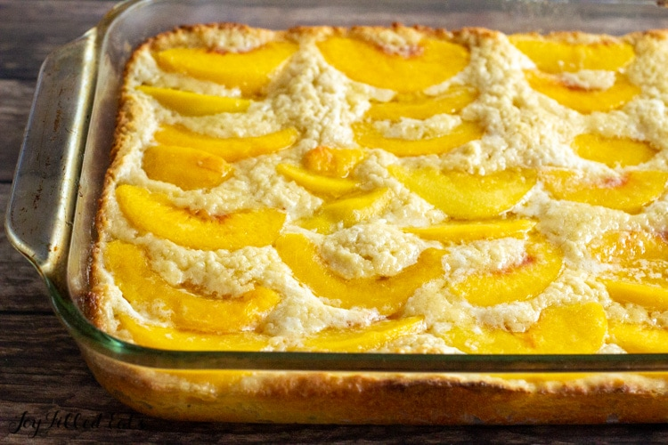 side shot of the keto peach cobbler baked in a 9x13 glass dish