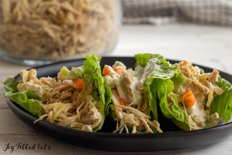 plate with keto pulled chicken on lettuce wraps