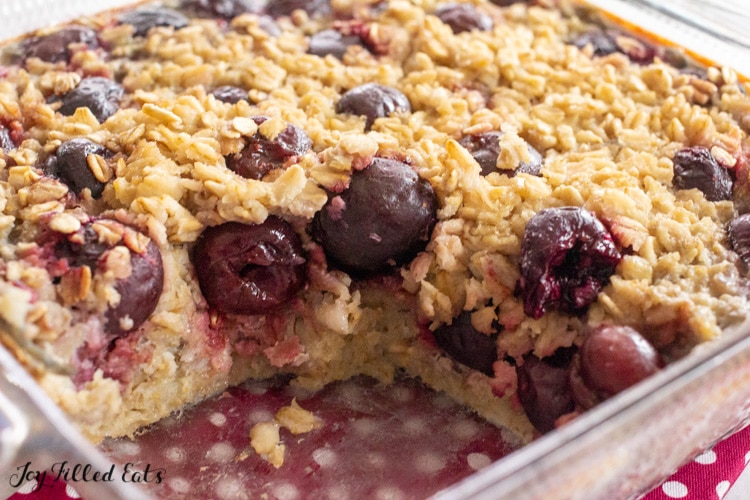 glass dish of baked cherry oatmeal missing a piece