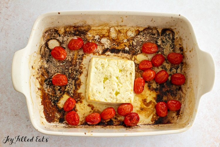 cheese and tomatoes in a casserole dish