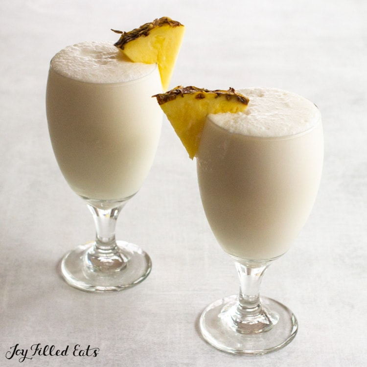 close up of two glasses with keto pina colada