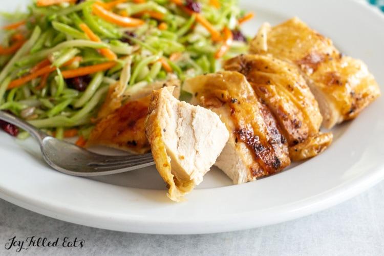 bite of chicken on a fork