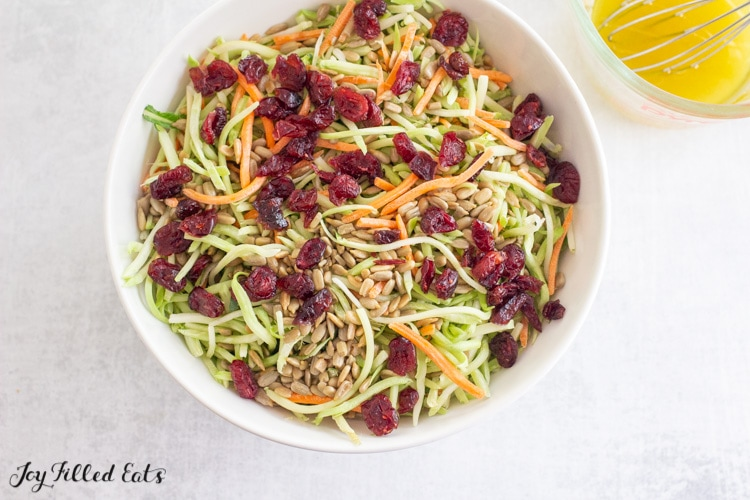 bowl with shredded vegetable and cranberries