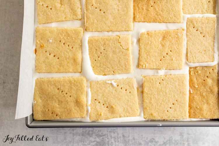 graham crackers being layered with filling