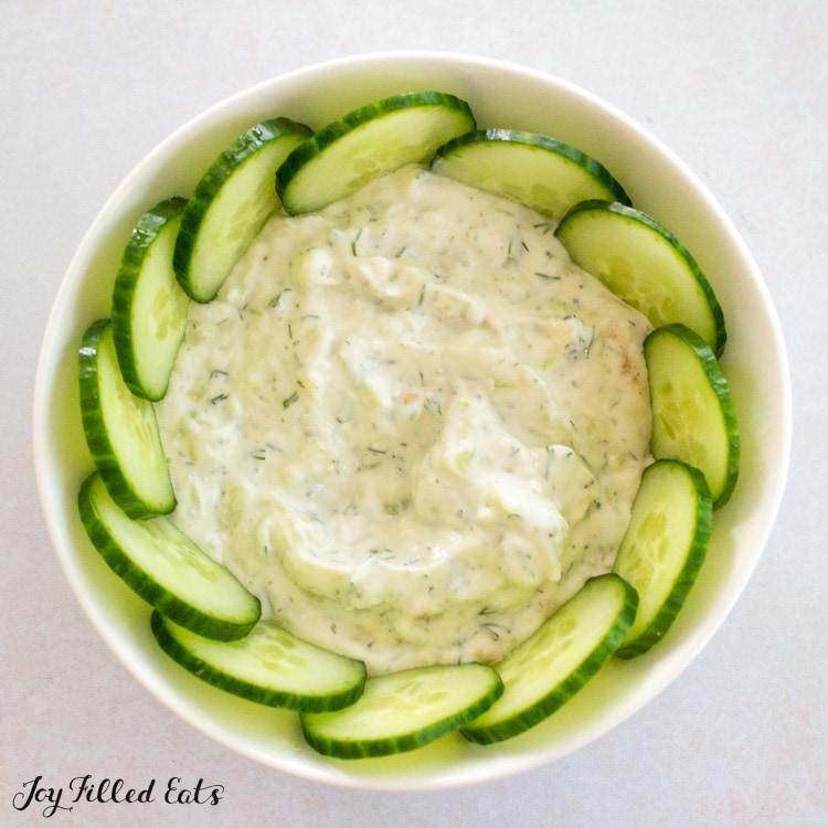 cucumbers in bowl of tzatziki around the rim