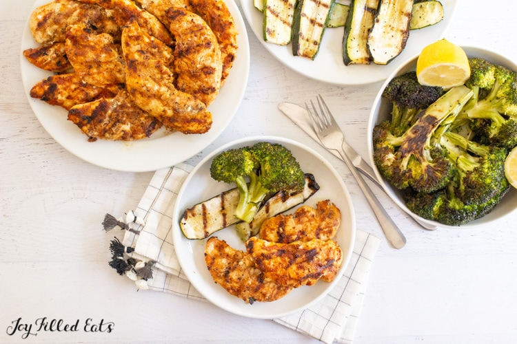 overhead shot of a tablescape with grilled chicken and vegetables