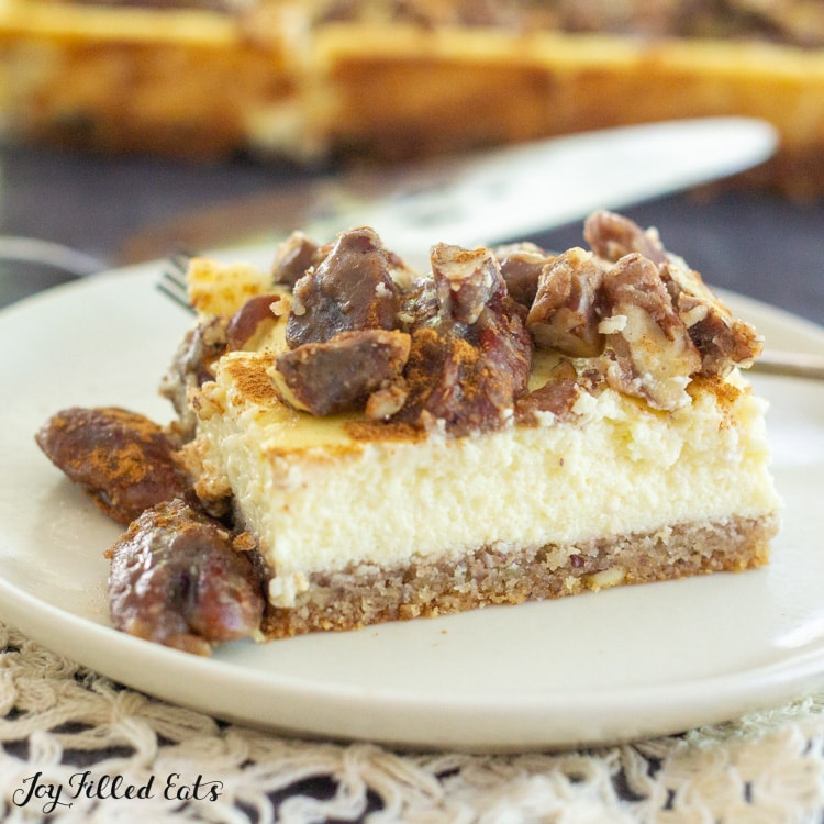 close up of a butter pecan cheesecake bar on a plate