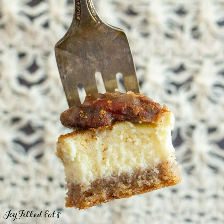 bite of butter pecan cheesecake on a fork