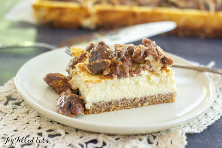 butter pecan cheesecake bars placed on a small white plate