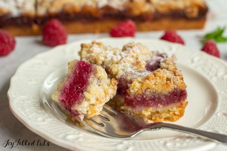 a bite of keto raspberry jam bar on a fork