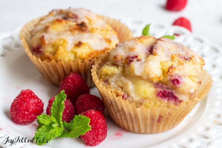 two keto raspberry muffins on a small plate