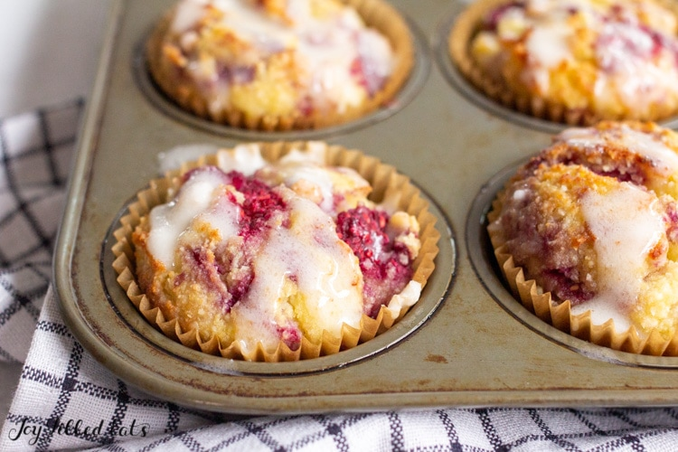 keto raspberry muffins with lemon glaze drizzled on top