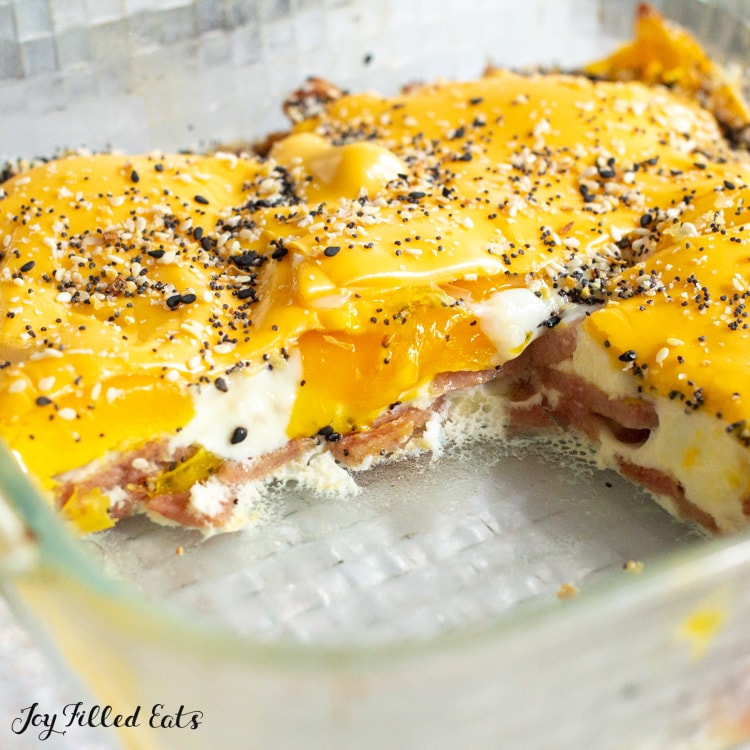 taylor ham egg and cheese casserole in a glass baking dish topped with everything bagel seasoning