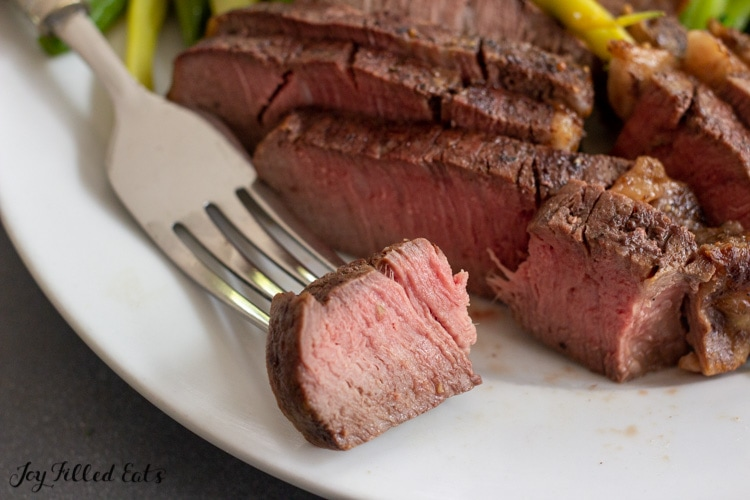 bite of steak on a fork