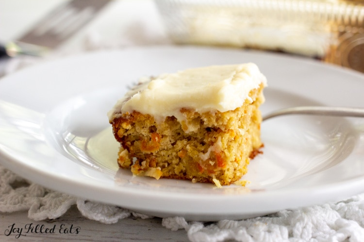 piece of almond flour carrot cake on a glass plate