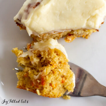 close up with a bite of almond flour carrot cake on a fork