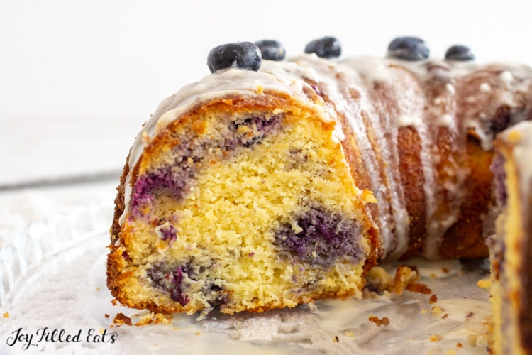 side view of the blueberry bundt cake missing a piece