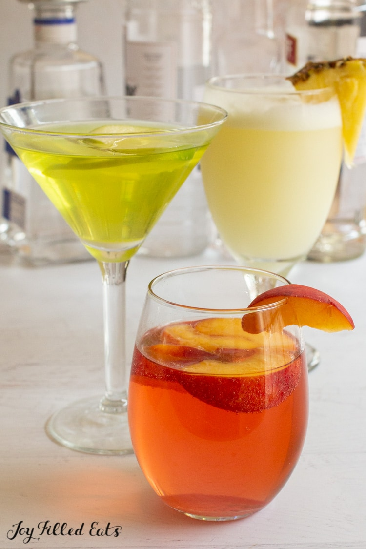 close up of glasses with mixed drinks
