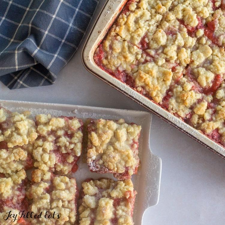 keto rhubarb crumble bars in pan and on platter