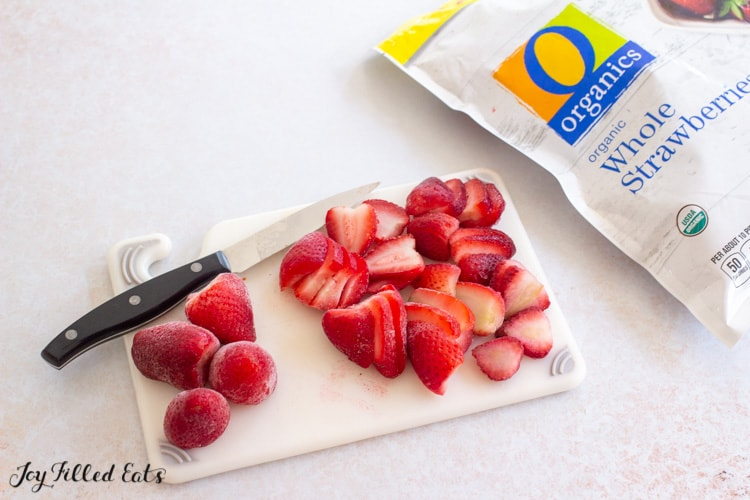 cutting board with sliced strawberries