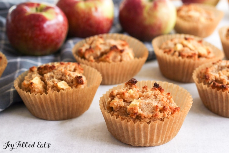 low carb apple muffins in front of some real apples