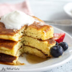 stack of three keto buttermilk pancakes with a piece cut out