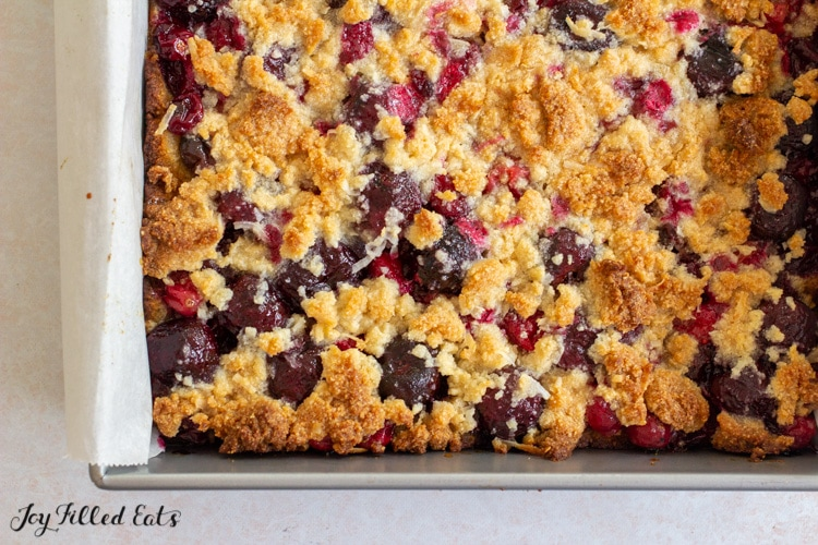 close up of baked sugar free cherry pie bars in the pan