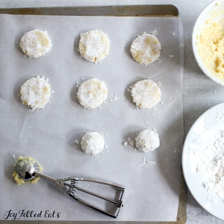 cookie scoop and dough balls on the baking sheet