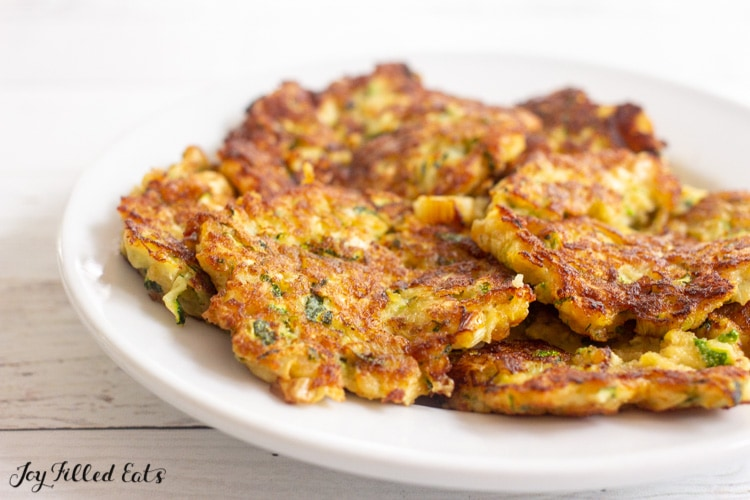 close up of zucchini fritters on a plate