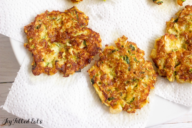 keto zucchini fritters on paper towels