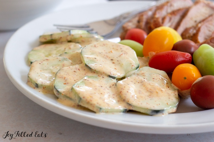 close up of keto cucumber salad on a plate
