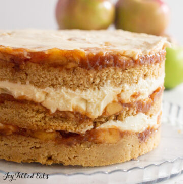 close up of apple cider donut cake on platter showing layers
