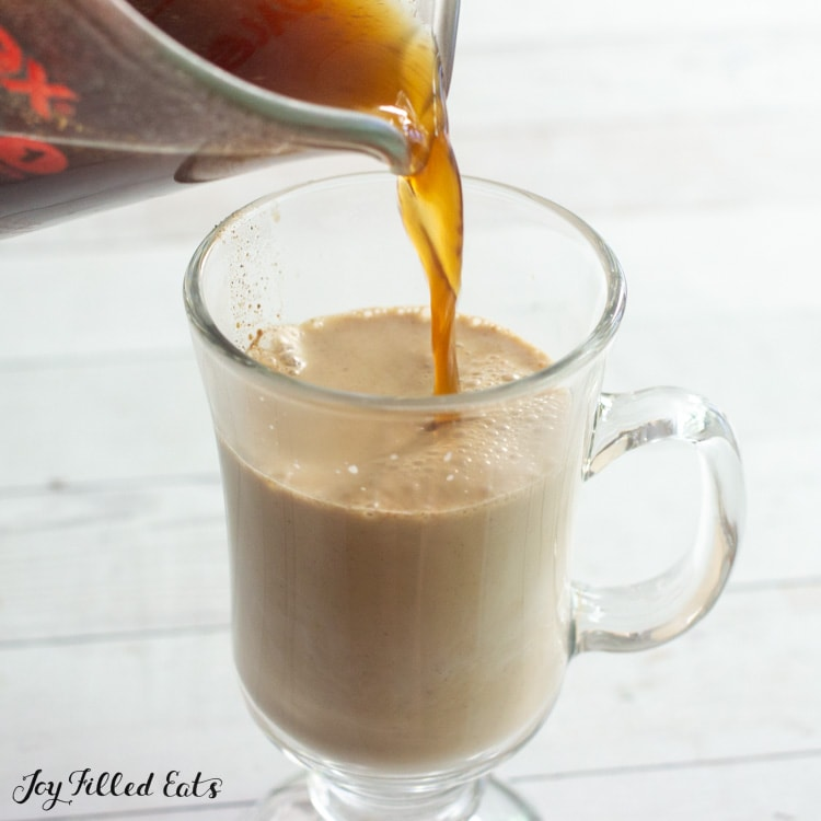 pouring the coffee over the cream mixture into the glass