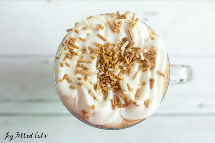 sprinkles and whipped cream on top of coffee