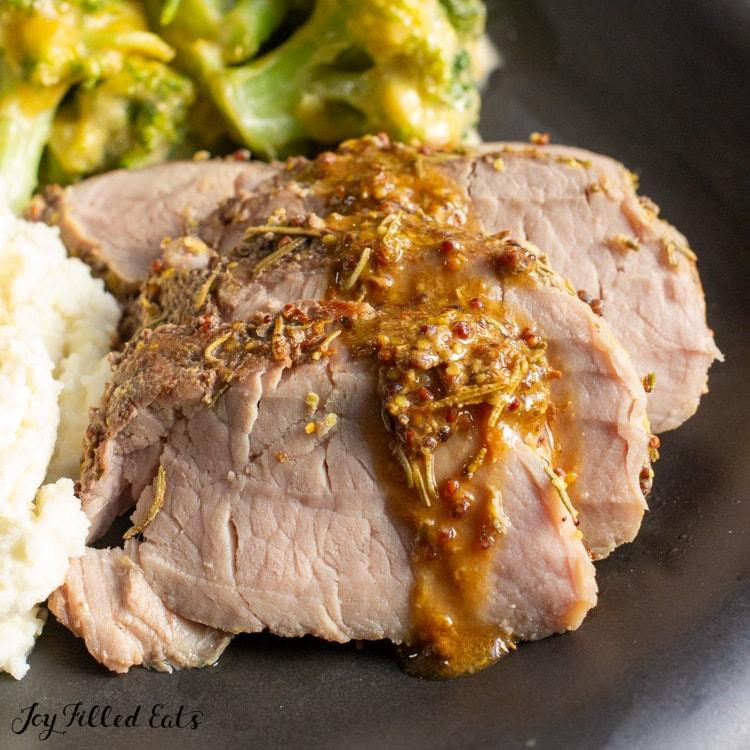 close up of gravy on the sliced pork tenderloin